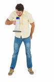 Young man shouting through megaphone Stock Photography