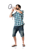 Young man shouting through megaphone. Royalty Free Stock Photography