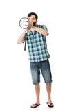 Young man shouting through megaphone. Royalty Free Stock Photos