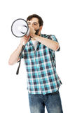 Young man shouting through megaphone. Stock Images