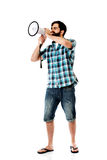 Young man shouting through megaphone. Royalty Free Stock Photos