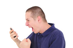 Young man shouting on the phone Stock Photography