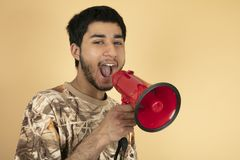 Young Man shouting in speaker Stock Image