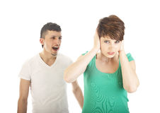 Young man shouting at young woman isolated Stock Photo