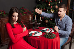 Young man shouts on dissatisfied woman. Young men shouts on dissatisfied woman, couple swear at luxury restaurant. Hard relationship stock images