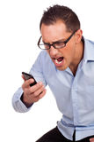 Young man shouts at his mobile phone Stock Photo