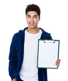 Young man show with the file board. Isolated on white background Stock Photos