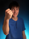 Young Man show the Fist Stock Image