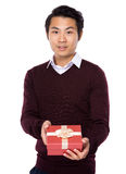 Young man show with gift box Stock Image