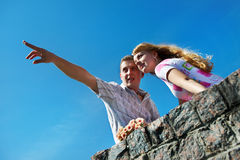 Young man show his girlfriend that in the distance Royalty Free Stock Photography