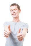 Young man show thumb up gesture Stock Images