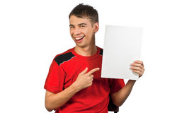 Young man is showing the advertisement. Stock Images