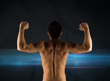 Young man showing biceps and muscles Stock Images