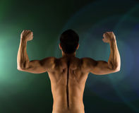 Young man showing biceps and muscles Stock Photo
