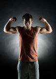 Young man showing biceps Stock Photo