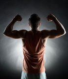 Young man showing biceps Royalty Free Stock Photography