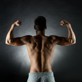 Young man showing biceps Royalty Free Stock Photo