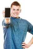 Young man showing black blank phone screen Royalty Free Stock Images