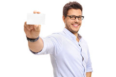 Young man showing a blank business card Stock Photo