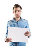 Young man showing a blank paper page. Ready for text or product, two clipping paths included, one for body and second for the page Stock Photo
