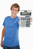 Young man showing a calculator Stock Images