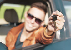 Young man showing car keys - Stock Image Royalty Free Stock Photography