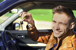 Young man showing car keys - Stock Image Stock Image
