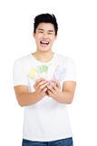 Young man showing currency notes Stock Image