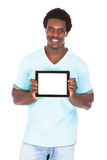 Young Man Showing Digital Tablet. Young African Man Showing Digital Tablet Isolated Over White Background Stock Images