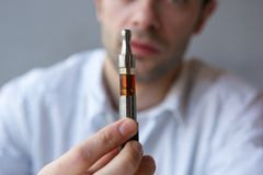 Young man showing electric cigarette close up Royalty Free Stock Photography
