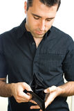 Young man showing empty wallet. Young man, showing his empty wallet Stock Photos