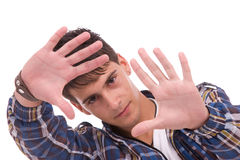 Young man showing framing hand gesture Stock Image