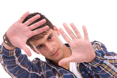 Young man showing framing hand gesture Stock Photography