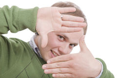 Young man showing framing hand gesture Royalty Free Stock Photo
