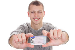 Young man showing his driver license Royalty Free Stock Image