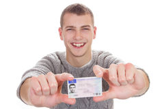 Young man showing his driver license. 16 to 18 year old boy just received his driver license Royalty Free Stock Photos