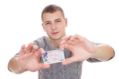 Young man showing his driver license Stock Photos