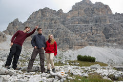 Young man showing his group the destination in the mountains Royalty Free Stock Photography