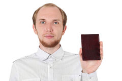 Young man in showing his id document isolated. Young man in white shirt showing his id documant isolated Royalty Free Stock Photo