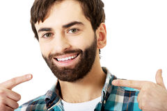 Young man showing his perfect teeth. Royalty Free Stock Photo