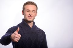 Young man showing his thumb up Stock Images
