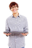 Young man showing laptop. Smiling college student holding closed laptop. Isolated on white background, mask included Royalty Free Stock Photography