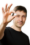 Young man showing medical pill Royalty Free Stock Images
