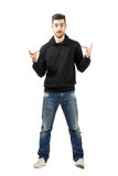 Young man showing metal music horns hand sign Stock Photo