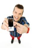 Young man showing mobile phone Royalty Free Stock Photo