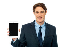 Young man showing newly launched tablet device Stock Photography