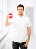 Young man showing no entry sign Stock Photo