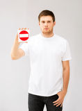 Young man showing no entry sign. Picture of young man showing no entry sign Stock Images