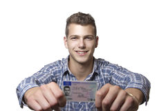 Young man showing off his driver license Royalty Free Stock Image
