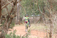 Young man showing off by popping wheelie at Mountain Bike Race Stock Image